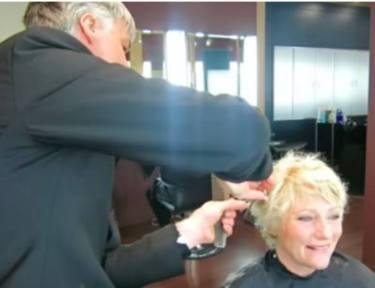 hair stylist giving woman a short cut