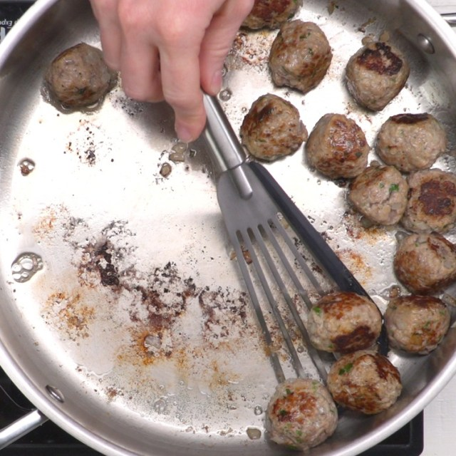 swedish meatballs cooking in pan