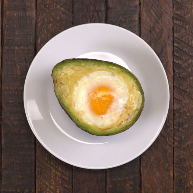 Baked Avocado Eggs finished on plate no toppings