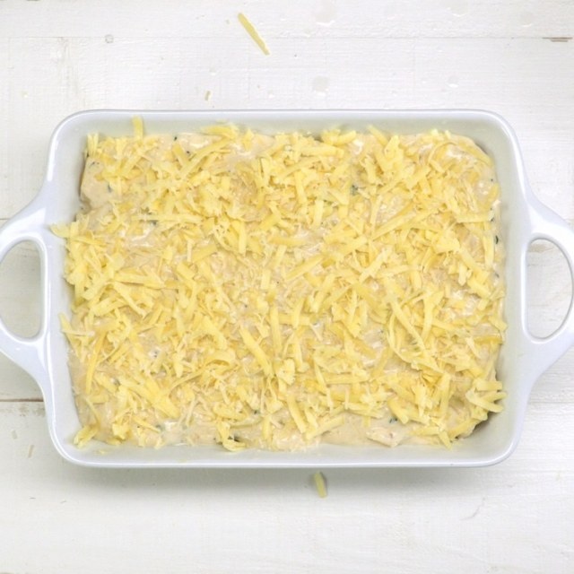 Scalloped Potatoes cheese in casserole dish