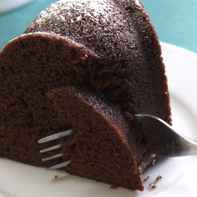 Stovetop Chocolate Bundt Cake cutting into slice