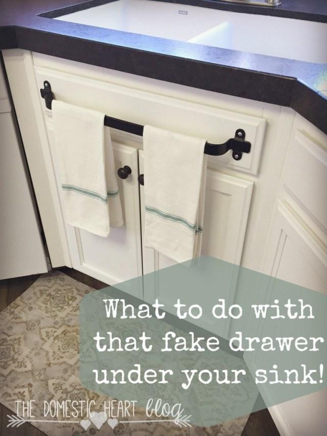 Towel bar on fake kitchen drawer.