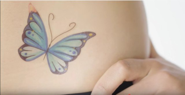 blue butterfly tattoo on hip