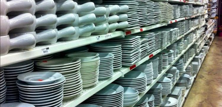 Image of dinnerware on shelves.