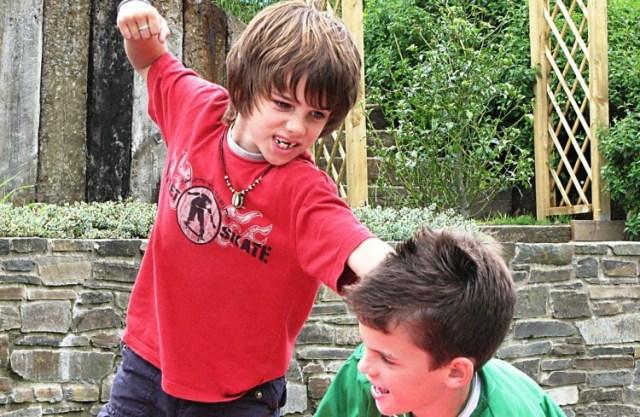Image of boys fighting.