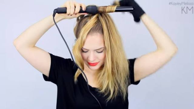 Use a ponytail to help curl hair with a curling iron