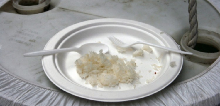 leftover rice on a plate with fork and knife
