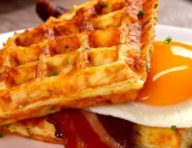 What do you get when you grill ham, eggs, cheddar cheese, and hash browns on a waffle iron? Outrageous savory waffles that make syrup totally irrelevant.