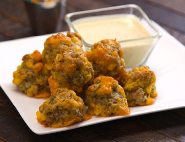 Our crowd-pleasing sausage balls recipe makes the easiest, tastiest, most addictive little party bites -- with just four ingredients.