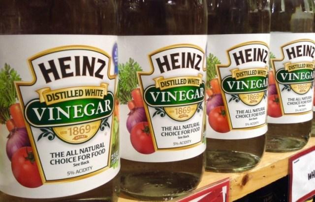 Shelf of bottles of Heinz distilled white vinegar