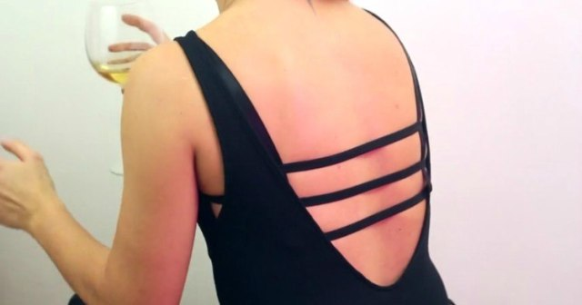 Image of open back shirt with bra showing.