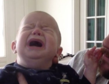 crying baby with father