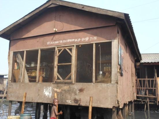 French & Yoruba inscriptions on a house
