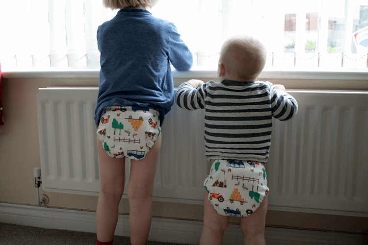 Ten months and three years old in Tots Bots EasyFit Star with Joules