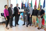 CARICOM ASG Joseph Cox presents the US$3000 first prize to Mr. Keron Bruce in the presence of CARICOM and GIZ officials