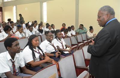 Barbados' Ambassador to CARICOM, Robert 'Bobby' Morris with students (Photo via BGIS)