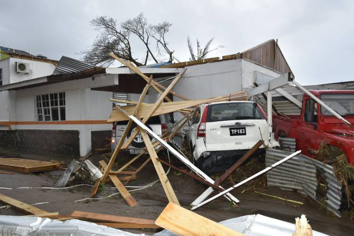 Damage to homes and vehicles in wake of  Hurricane Maria