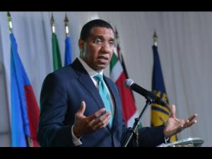 Prime Minister Andrew Holness addressing the IMF High Level Caribbean Forum yesterday.