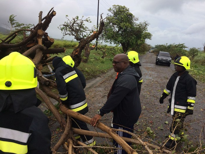 Irma_PM Harris assisting officers of the Fire and Rescue Services clear the island main road of debris