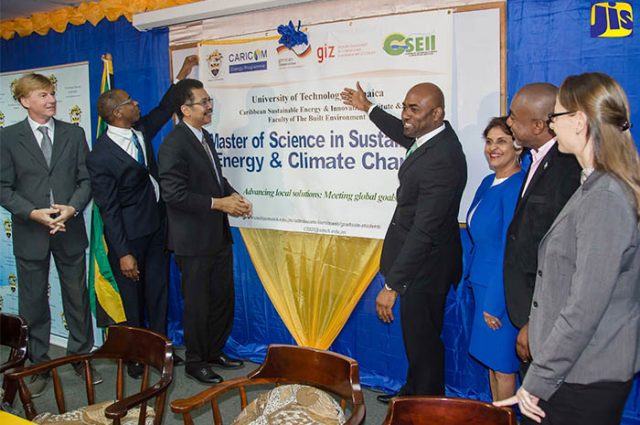 Minister of Science, Energy and Technology, Dr. the Hon. Andrew Wheatley (centre), officially launches the Sustainable Energy and Climate Change Master's Degree Programme at the University of Technology (UTech), yesterday (March 2) at the school's Papine campus. Others (from left) are Charge d'Affaires at the German Embassy, Michael Dumke; Dean, Faculty of the Built Environment at UTech, Dr. Garfield Young; President of UTech, Professor Stephen Vasciannie, CD.; UTech's Sustainable Energy Head, Dr. Ruth Potopsingh; Manager, Energy, CARICOM Secretariat, Dr. Devon Gardner, and Representative from the German Society for International Cooperation (GIZ) in the Dominican Republic, Anya Shwerwin. (Photo via JIS)