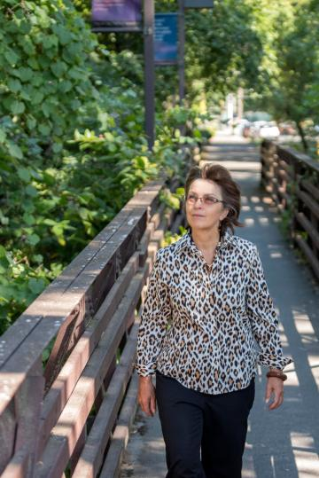 New President Gayle Hutchinson walks across a bridge around campus to greet staff on her official first day of work on Tuesday, July 5, 2016 in Chico, Calif. (Jason Halley/University Photographer)