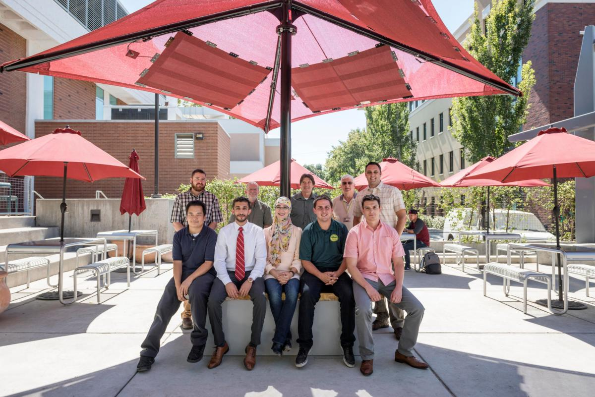 Student engineers Chao Vang, Maytham Alhaddad, Salam Ali, Erik Marquis, and Jairo Orozco (left to right) unveiled the nation's first student-designed/built solar charging station using thin-film photovoltaic panels, next to the BMU, for a media event for Thursday, August 25, 2016 in Chico, Calif. (Jason Halley/University Photographer)