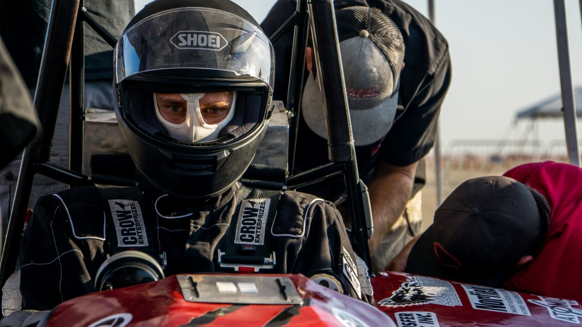 Chico State student Spencer Johnson sits in the team's car waiting for the endurance race at the SAE Formula international competition.