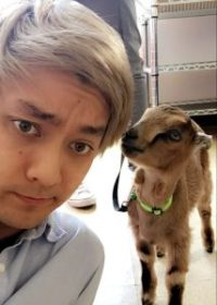 Jeff Barron and a baby goat.