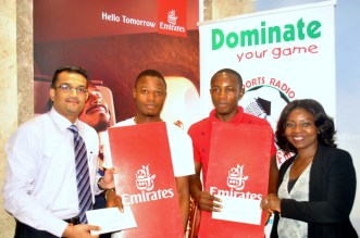 L-R : Emirates Airline Regional Manager West Africa, Mr Manoj Nair; Grand Winners of the Competition, Alao Olamilekan and Alfred Chiedozie; and Emirates Sales Manager, Lagos, Mrs Mary Gbobaniyi at the presentation of tickets to the Grand Winners of the Emirates FA Football Competition, recently in Lagos.