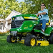 The John Deere X330 Select Series Tractor Mower offers more horsepower while maintaining a clean cut. (PRNewsFoto/John Deere)