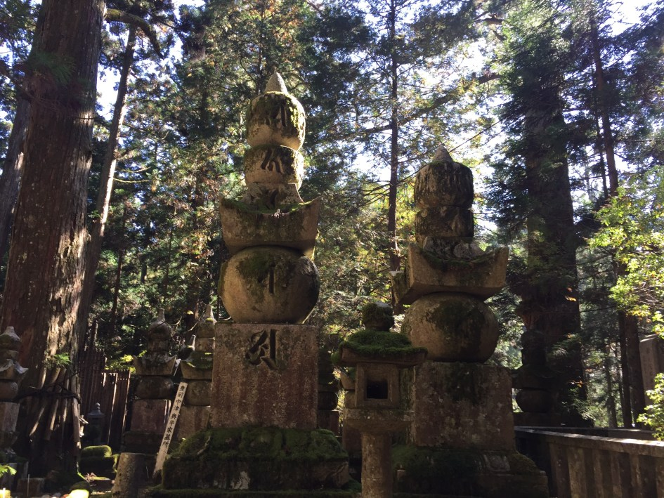 These different parts of small Buddhist pagodas known as Gorinto in the cemetery that are said to represent the Five Elements including water, air, earth, fire, and energy, or void