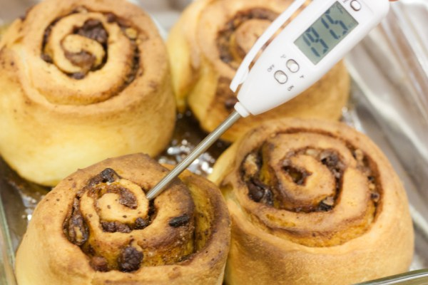 Checking cinnamon rolls for donness
