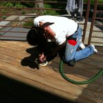 Rachel getting down on a deck restoration