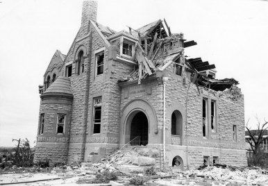 The tornado cut a path across Washburn University at S.W. 17th and College Avenue, destroying five major buildings and damaging several other structures and hundreds of trees. Shown here is Boswell Hall.