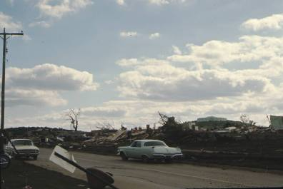 Burnett's Mound is shown in the background of this image of a tornado-damaged neighborhood.