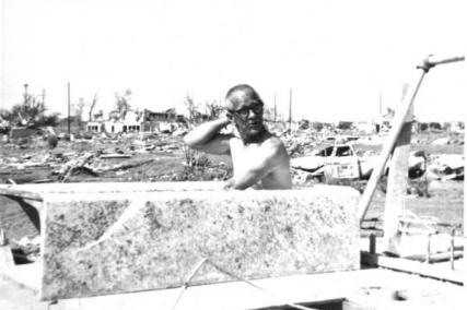 A couple of days after the storm, Tom West's father, Frank, showed his sense of humor by posing for a photograph inside their bathtub amidst the rubble of their home