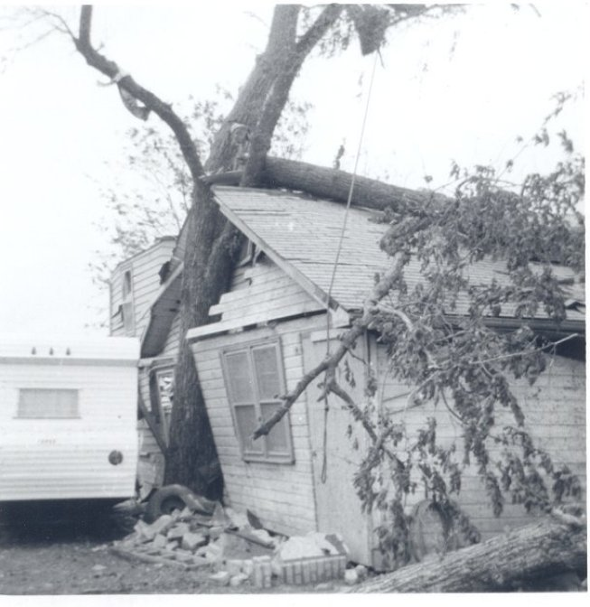 The home at 2712 N.E. Seward Ave., where Linda Hansford Balyga lived with her family, was damaged when the tornado slammed it against a tree.