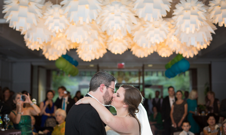 kissing couple with bloom lights wedding