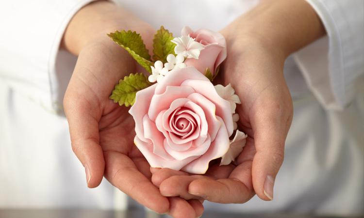 hands with sugar flower