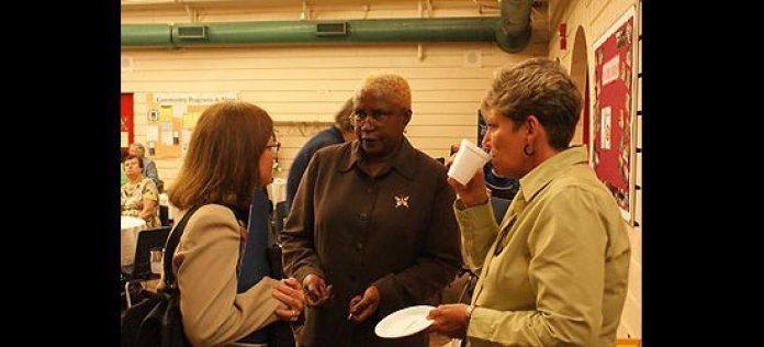 Zephine Wailoo, coordinator at Port Union Community and Recreation Centre, talks with attendees at the centre's 25th anniversary celebration Sept. 21.