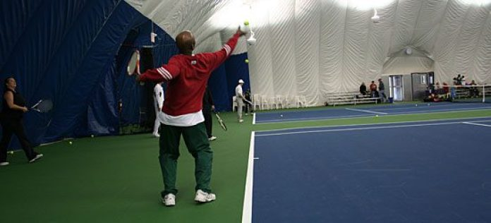 Wilson Bedeau shows how to serve (2/4).