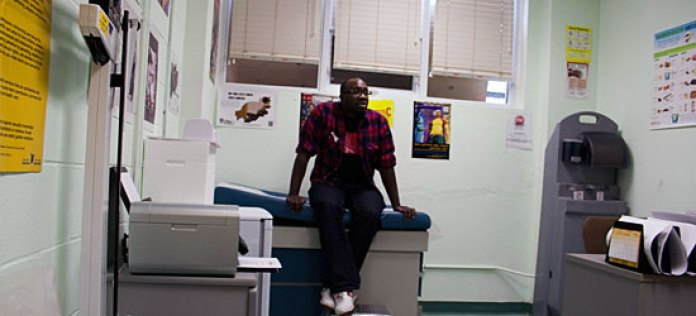 Paul Taylor, executive director of Second Base Youth Shelter, sits in the shelter's onsite clinic.