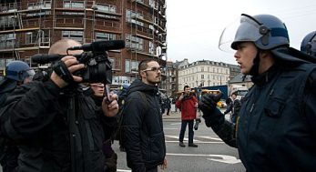 Police and protesters faceoff on the streets of Copenhagen.
