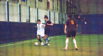 Victoria Park's #10 gets tripped up by East York's #17.