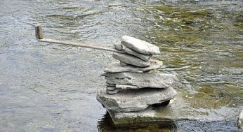 One of Toronto photographer Peter Riedel's 39 rock sculptures, discovered on the weekend in the Humber River near the old Mill, seemingly defies gravity. Riedel's secret? Practice and counterbalancing.