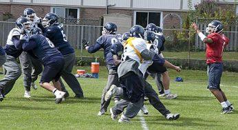 Argos quarterback Cleo Lemon runs a pass play from single-back formation.