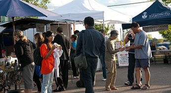 Visitors to the market browse through the diverse selection of vendors.