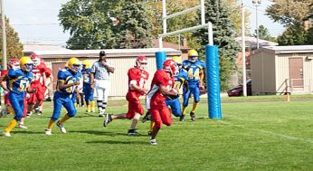 Danforth Collegiate and Technical Institute's Ashton Roy (centre) trots into the end zone for one of his five touchdowns against Sir Robert L. Borden Business and Technical Institute on Oct. 6. Danforth cruised to an easy 48-0 win.
