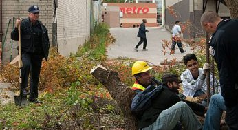 Toronto Policemen share a laugh volunteers and a Toronto Hydro employee as they admire the work they have done to make this walkway a safer way to travel.