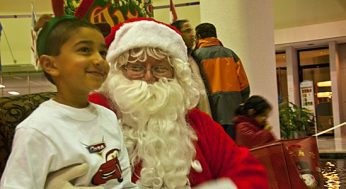 Santa puts a smile on a child's face at the Scarborough Civic Centre tree-lighting event Dec. 1. The event also included performances from several groups and crafts for kids.